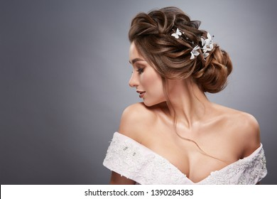 brunette looking down with flowered hairstyle