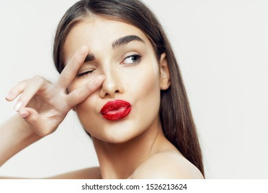 Brunette make up red lips two fingers look sideways cropped view
