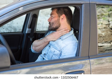 Brunette male driver with sore throat in a car