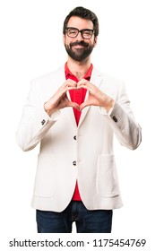Brunette man with glasses making a heart with his hands on white background