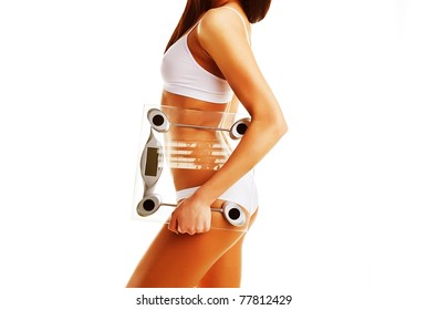 Brunette model with scales in hand on white background