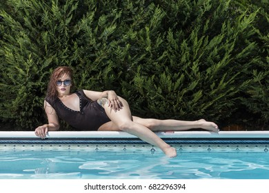 A brunette model in a swimming pool environment