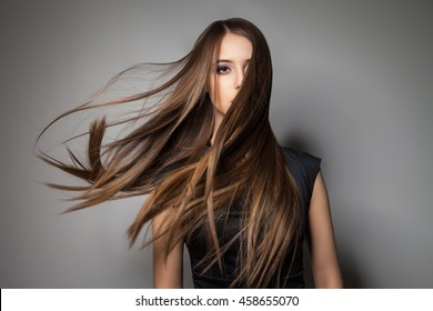 Brunette model with windy hair