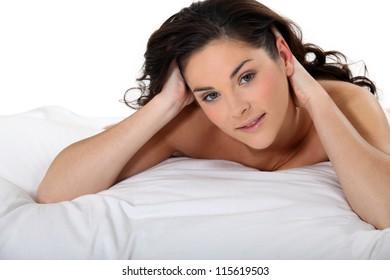 Brunette naked in bed