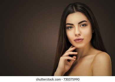Brunette portrait hairdresser salon.  Seductive woman, fresh healthy skin, skincare and cosmetology concept, rejuvenation therapy and treatment