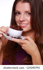 Brunette pretty smiley girl with cup of aroma arabica coffee beans