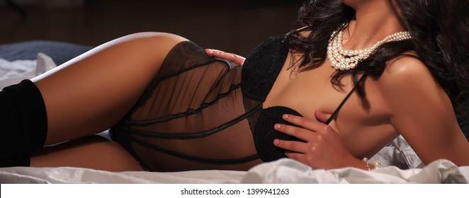 brunette sexy caucasian girl in black lingerie