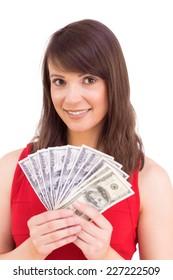 Brunette showing fan of dollars on white background