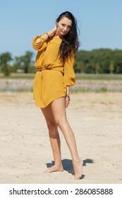 Brunette slim girl on a beach