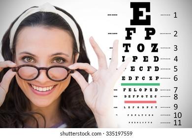 Brunette smiling at camera against eye test