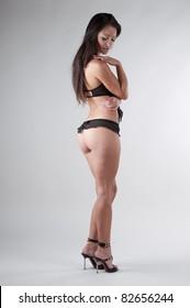 Brunette in standing in black lingerie