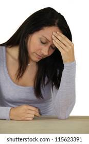 Brunette suffering from bad headache