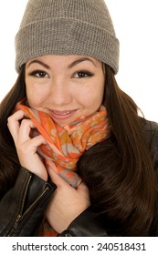 Brunette teen model snuggling hat and beanie