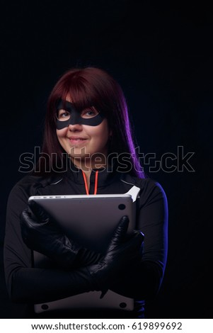 Brunette Thief Holds Stolen Laptop Stock Photo (Edit Now
