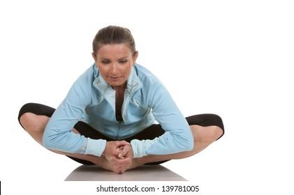 brunette wearing fitness wear on white background