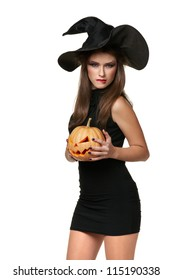 The brunette woman in a black dress with a pumpkin