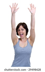 Brunette woman cheering with her hands in the air, isolated on white background.