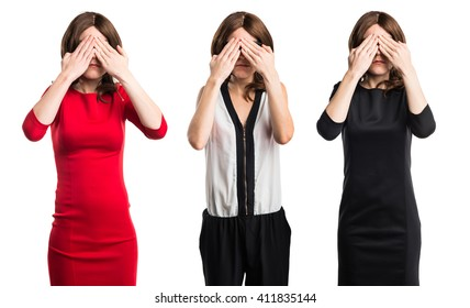 Brunette woman covering her eyes