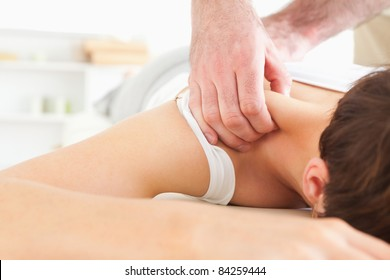 Brunette Woman getting a neck-massage in a room