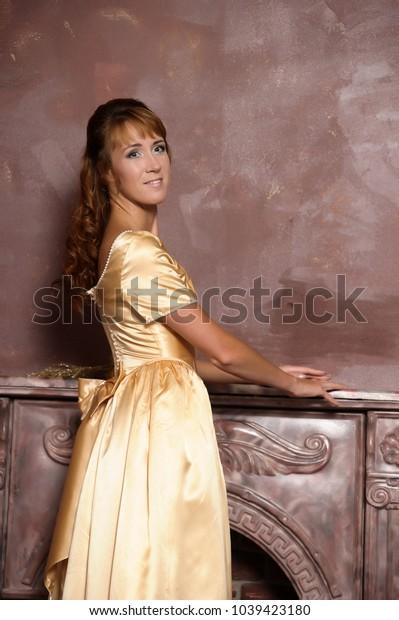 brunette woman in golden retro dress