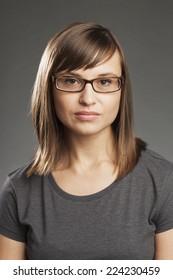 Brunette woman in grey shirt. Closeup Portrait