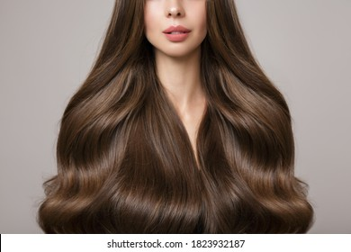 Brunette woman hair. Large curls