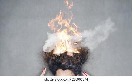 brunette woman head hair on fire