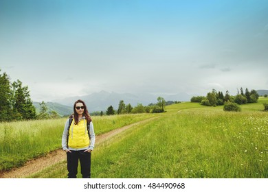 brunette woman hiker hiking on trail in summer time. Tatra mountain in Poland.