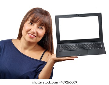 Brunette woman holding laptop with blank screen isolated