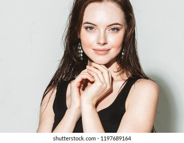 Brunette woman with long hair beautiful face portrait