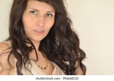 brunette woman with long wavy hair