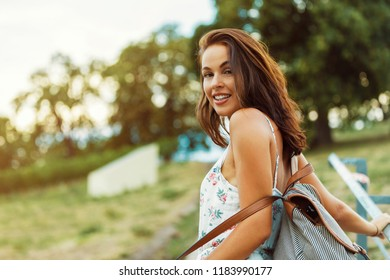 brunette woman looking back over shoulder