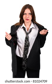 Brunette woman in a mens suit looking irritated