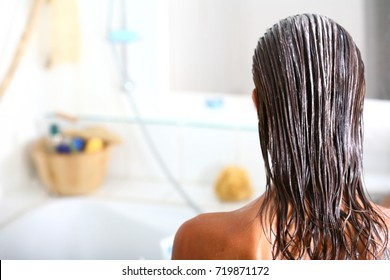 brunette woman with a nourishing mask on her hair