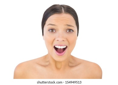 Brunette woman screaming at camera against white background