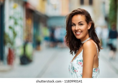 brunette woman smiling into the camera