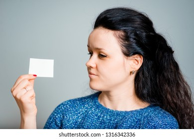 brunette woman with sticker isolated on gray background