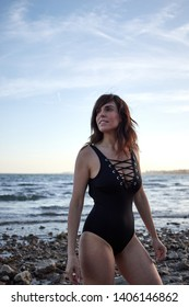 Brunette woman with swimsuit on the beach