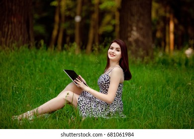 Brunette woman talking in a video call on line on nature