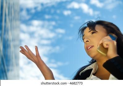 Brunette woman using her phone, gesturing
