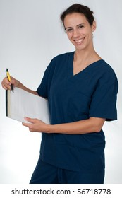 brunette woman wearing blue scrubs against white background