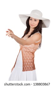 Brunette woman in white sun hat in a white dress, on white background, someone selects and shows his finger