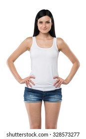 Brunette woman is in a white tank top and blue denim shorts. isolated.