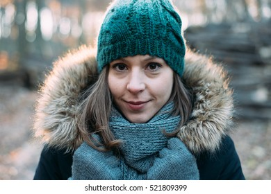 Brunette woman. Winter portrait in forest.