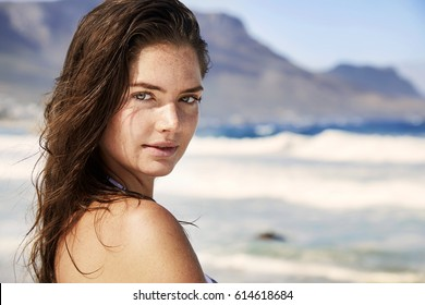 Brunette young woman on beach, portrait