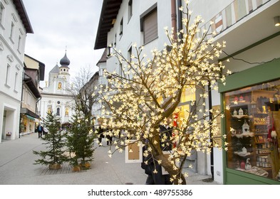 Brunico, Italy, 14 December 2014: a christmas lights tree decoration outside a shop in the San Candido village