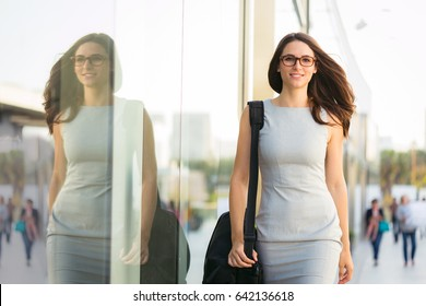 Brunnette female young beautiful educated confident stylish business look on her way to work