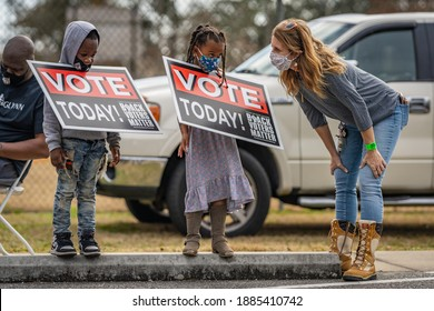 Brunswick, Georgia USA - December 31, 2020: Scenes from the Collard Green Caucus food giveaway, sponsored by Black Voters Matter and A Better Glynn, held at Ballard Park.