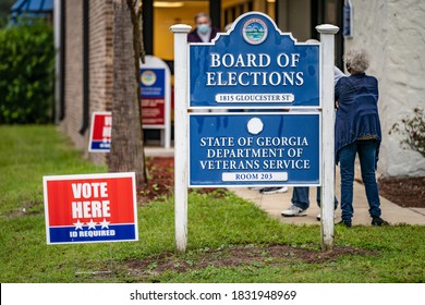BRUNSWICK, GEORGIA / USA - October 12, 2020: The first morning of early voting in Georgia began with lines at the Brunswick polling station and candidates' boosters on the street.