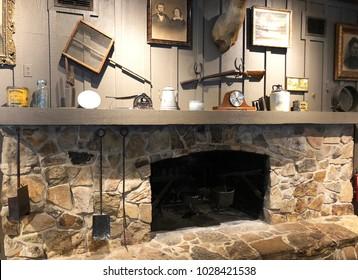 BRUNSWICK, GEORGIA-FEBRUARY 7, 2018:  Nostalgic stone fireplace inside a Craker Barrel restaurant and Old Country Store.